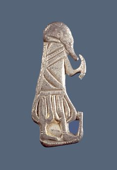 Silver figure of a man with drinking-horn. Dated to the Viking period (AD 800-1050). Height 3,5 cm.