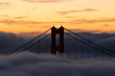 The Golden Gate Bridge Turns 75. The north tower of San Francisco's iconic Golden Gate Bridge was blanketed by fog as the sun rose on Oct. 8, 2007. On many days, ethereal white puffs envelope the city's most famous attraction, then recede.