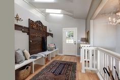 This mudroom features skylights, a sizable bench, and several baskets for storage. Lower level hooks are handy for little ones. Source: http://www.zillow.com/digs/Home-Stratosphere-boards/Random-Rooms-I-Like/