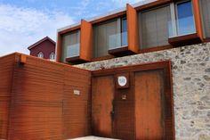 house exterior design facade stone wall and iron elements