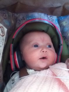 My baby sister listening to my music