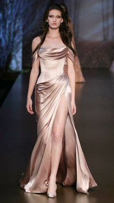 Ralph & Russo Rose Gold evening gown, sleek and stunning! Enjoy RUSHWORLD boards, UNPREDICTABLE WOMEN HAUTE COUTURE, WEDDING GOWN HOUND and EYE CANDY ARCHITECTURAL MASTERPIECES. Follow RUSHWORLD! We're on the hunt for everything you'll love! #UnpredictableWomenHauteCouture #WhatToWear #WeddingGown