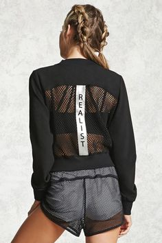 """A woven athletic zip-up jacket featuring a mesh-paneled front and back, a vertical """"Realist"""" colorblocked graphic on the back, long sleeves, and ribbed trim."""