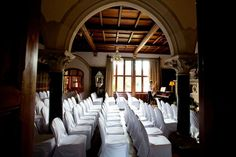 Great Hall - set up for a ceremony with covered conference chairs - Huntsham Court