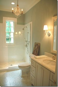 First of all, I love the ambiance of this bathroom. Secondly, I love showers like that!