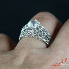 White Sapphire Solitaire Filigree Milgrain ring by WanLoveDesigns - I don't like the band with this engagement ring--too wide  overly decorative.  I do like the scrolling again on the band though.
