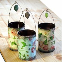 Repurposed tin cans made by decoupaging napkins - these are so pretty!