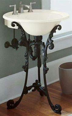 A black iron pedestal sink that brings the charm of ornate antique furniture. A black iron pedestal sink that brings the charm of ornate antique furniture. Sink, Decor, Kohler, Gothic Furniture, Bathroom Decor, Home, Bathroom Design, Beautiful Bathrooms, Pedestal Sink