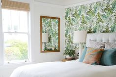 Wallpaper inspired by greenery, mid-century modern furniture and gorgeous vaulted ceilings all make this renter smile every day.