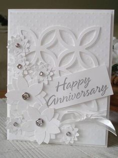 white on white, elegant card. could be sympathy too.