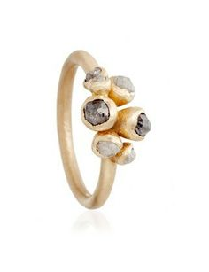 Instead of transparent or black diamonds, go for shades of grey. GREY DIAMOND CLUSTER RING, $1,750, RUTH TOMLINSON, ASTLEYCLARKE.COM