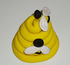 Photo of polymer clay beehive with little bees.