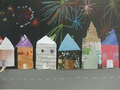 Huizen maken met papier uit tijdschriften en deze op papier geplakt waar de kleuters vuurwerk hebben getekend. Leuk groepswerk