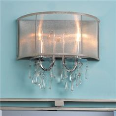 Modern Glam Shaded Sconce Silk shimmer shade highlights the metal finishes of this wall sconce or bath vanity light accented with pear crystal pendalogues. Choose from Aged Brass with gold sheer shade with or Chrome with silver sheer shade. Salon Lighting, Sheer Shades, Bathroom Vanity Lighting, Unique Lighting, Drum Shade, Home Interior Design, Wall Sconces, Light Up, Ceiling Lights