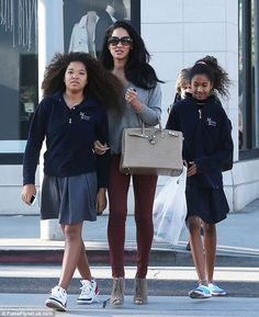 Thick-haired trio: Kimora Lee Simmons took her gifted daughters Ming, 14, and Aoki, 11, shopping after school in Beverly Hills Wednesday.  Both have It's of 145 or above -  are those Mensa sweaters they are wearing?