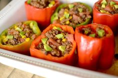 Healthy Burrito Bowl Stuffed Peppers are a delicious dinner that tastes exactly like a chipotle burrito bowl in pepper form! Also paleo, vegan and whole 30!