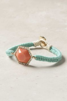Turquoise and Coral. Just braid string and tie through clasps.