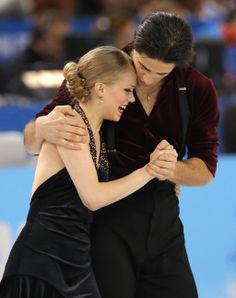Kaitlyn Weaver and Andrew Poje of Canada embrace after competing in the ice dance free dance figure skating finals at the Iceberg Skating Pa...