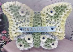 Butterflys are becoming quite popular.. This one was designed by Four Seasons Florist using a Val Spicer frame.
