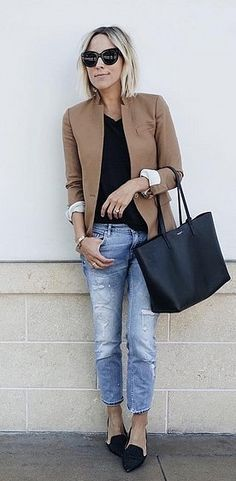 With a Neutral Blazer, Complementing Tee, and Baggy Jeans