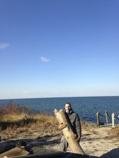 Daniel carrying back a very large beach log to be turned into 2 side tables.