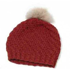 Cap with fur pompon