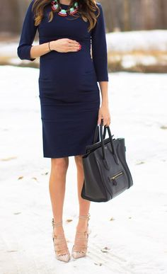 Elegant pregnant woman in navy dress and nude heels.  maternitywear #maternitystyle #stylishpregnancy