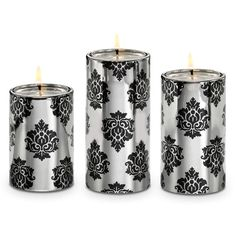 """Elegant patterned ceramic holders have the look of a pillar but hold a tealight inside, sold separately. One of each height: 6"""" (15 cm) h, 5"""" (13 cm) h, 4¼"""" (11 cm) h. Giftable packaging"""