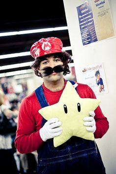 Make a Mario Costume for Halloween and cosplay and fly away into the stars, fighting Bowser and attempting at every turn to rescue Princess Peach. Mario Halloween Costumes, Mario Costume, Learn Yoga, Best Cosplay, Mario Bros, Cosplay Costumes, Bowser, Stuff To Do, Dinosaur Stuffed Animal