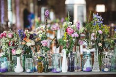 Tiffany says, Our centerpieces were definitely a labor of love. We spent close to two years collecting vintage jars and vases. My Maid of Honor, Danielle, ...