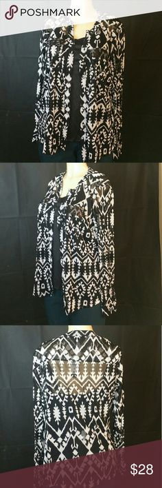 I. N.C International Concepts Idol Ikat 2-pc Blous I. N.C International Concepts Idol Ikat, size Small 0X,  Long Sleeve  Printed Semi Sheer 2-Piece Blouse and tank Set, the iside tank has spaghetti straps is color solid black, the outside blouse is button-down,  round neckline with long sleeves, color black and white blend, two front pockets on upper front with black accents, made of nylon and polyester blend, comes new with tags in good cosmetic condition great for any formal outfit. I. N.C…