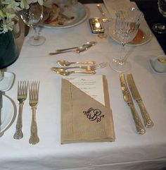Wedding tablescape with embroidered napkin envelope for the menu.