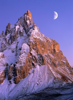 Pala and Moon San Martino di Castrozza, Italy  Cimon della Pala and the moon at sunset. This image was made with a double exposure on film to make the moon the same size I saw it and not just a speck in the distance. It was a beautiful night!  Photo © copyright by Grant Ordelheide.