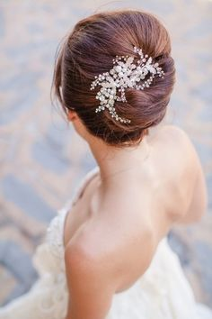 pearl pins glam up an updo bridal hairstyle