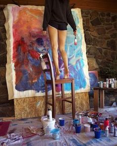 Sarah Sandin at work. I like the simplicity of a girl, her ladder and brush, and the unstretched work, simply tacked on plywood. Inspiration requires work - grab it!