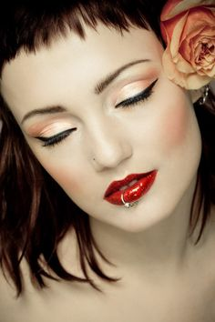 Girl with red lipstick & flower in hair
