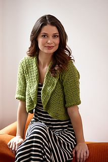 This unique shrug features a circular construction that makes it interesting to crochet. Designed by Lily Chin. (Lion Brand Yarn)
