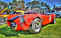 Red 1965 Shelby Cobra race car with black center stripe on display at Car Show in Melbourne Australia