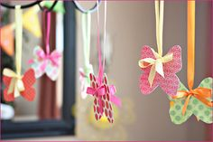 butterflies hung from ribbons