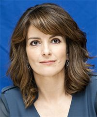 shoulder length layered with thick side swept bangs - great as a growing out style (Tina Fey)