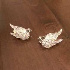 "vintage wing clip on earrings from Sarah Coventry's bird of paradise collection. silver tone with Aurora boreal rhinestones. about 1"" by 3/4"". excellent condition and no yellowing. Vintage Jewelry Earrings"