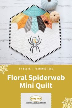 The itsy bitsy spider didn't go up the water spout! She actually landed herself on this beautiful mini quilt that features a Dresden spiderweb. // Fall-Inspired Mini Quilt by Bev McCullough   Flamingo Toes @bevrmccullough // Project Instructions and Floral Design available to create this fun and cute Halloween sewing project