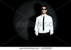 Portrait of a handsome man over black background. - stock photo