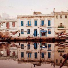 The port of Bizerte.  #igerstunisia #africa #northafrica #tunis #tunisia #tunisie #trbeauty #comment #follow #follow4follow #like4like #trp #tunisia #tunisie  #bizerte #reflection #water #boat #overeditingisfun #door #port