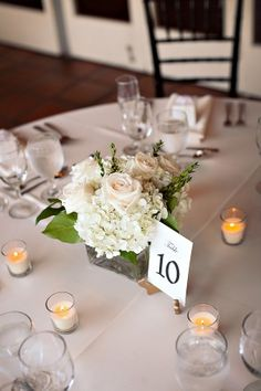 Beautiful white hydrangea and rose centerpiece. Thanks for showing it to me @Magy Brown