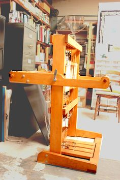 Ahrens Loom, two-beam, it can turn vertically for storage. Four heddles.