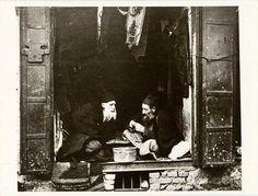 merchants at a shop entrance