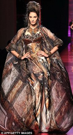 Jean-Paul Gaultier, can do with out the flowing jacket, at least not as long as it is.