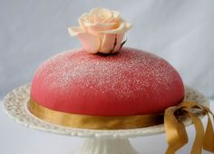 A Swedish Princess Cake, Prinsesstårta, is a sponge cake filled with layers of cream and topped with a layer of, usually green, marzipan. It is also usually decorated with some confectioner's sugar and a red rose made from marzipan. Gluten free recipe on A Gluten-Free Day, 3/09/2009