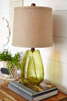 Skilled artisans work bubbles into the blown glass of Pier 1's Seeded Glass Lamp to give it that unique look. It's a natural for a refreshing spring accent.